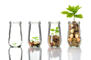 growing jars of money representing passive income